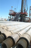 Mining Photo Stock Library - pipe casing laid out in front of drill rig ( Weight: 1  New Image: NO)
