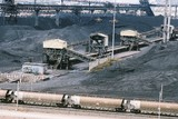 Mining Photo Stock Library - heavy rail carts emptying coal at wharf terminal with stockpiles coal in background ( Weight: 1  New Image: NO)