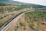 Mining Photo Stock Library - long coal train winding its way over a bridge and through rural countryside with car highway adjacent. aerial shot ( Weight: 1  New Image: NO)