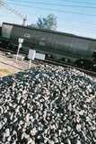 Mining Photo Stock Library - heavy rail carriage moving past a crossing in rural countryside ( Weight: 4  New Image: NO)