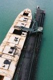 Mining Photo Stock Library - ship loader loading coal into hold at wharf.  aerial shot ( Weight: 2  New Image: NO)
