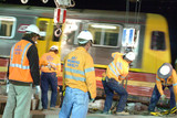 Mining Photo Stock Library - workers in PPE at night on construction site with light rail train zooming past ( Weight: 1  New Image: NO)