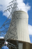 Mining Photo Stock Library - worker at power station looking up at cooling tower ( Weight: 1  New Image: NO)