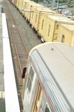 Mining Photo Stock Library - looking down on a goods freight train passing a light rail passenger train next to a domestic station ( Weight: 1  New Image: NO)
