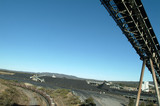 Mining Photo Stock Library - coal conveyor loader above with heavy rail train carriage below and coal stockpiles in background. ( Weight: 2  New Image: NO)