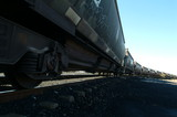 Mining Photo Stock Library - heavy coal train carriages on track.  shot from ground level ( Weight: 4  New Image: NO)