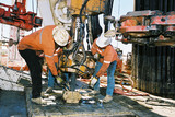 Mining Photo Stock Library - workers on oil gas rig attaching pipe in the hole ( Weight: 1  New Image: NO)