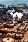Mining Photo Stock Library - aerial of bauxite refinery with port in background. ( Weight: 3  New Image: NO)