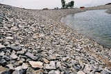Mining Photo Stock Library - rock wall edge of dam lake water feature in a property subdivision ( Weight: 3  New Image: NO)