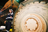 Mining Photo Stock Library - underground mine worker standing next to wheel of machinery ( Weight: 2  New Image: NO)
