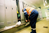 Mining Photo Stock Library - mine worker changing boots in locker room ( Weight: 5  New Image: NO)