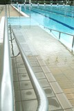 Mining Photo Stock Library - handicapped disabled access ramp into public swimming pool ( Weight: 5  New Image: NO)