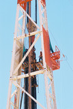 Mining Photo Stock Library - drill rig worker high up the derrick loading pipe into the hole ( Weight: 1  New Image: NO)