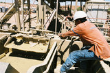 Mining Photo Stock Library - oil and gas rig worker tightening a valve on a rig.  shot from the side. ( Weight: 1  New Image: NO)