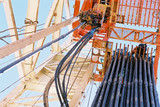 Mining Photo Stock Library - looking up the derrick on a drill rig site to see stacked pipe ready to load into the drilled hole. ( Weight: 1  New Image: NO)