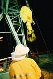 Mining Photo Stock Library - oil and gas rig worker next to derrick hook. shot from behind ( Weight: 1  New Image: NO)