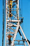 Mining Photo Stock Library - oil and gas rig worker climbing up the derrick with safety harness on.  derrick hook in the background. ( Weight: 1  New Image: NO)