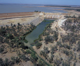 Mining Photo Stock Library - aerial of major outback dam.  depicts dam wall, overflow surrounding vegetation and water in stock. ( Weight: 3  New Image: NO)