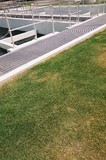 Mining Photo Stock Library - green grass to the edge of water treatment plant ( Weight: 3  New Image: NO)