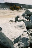 Mining Photo Stock Library - large hard metal overburden rocks in foreground with working loader in background ( Weight: 3  New Image: NO)