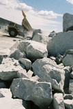 Mining Photo Stock Library - haul truck tipping its load onto stockpile in background with hard metal rocks in foreground. ( Weight: 3  New Image: NO)