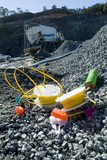 Mining Photo Stock Library - colourful blasting equipment next to blast hole on mine site quarry.  close up at ground level with blast truck and gear in background. ( Weight: 1  New Image: NO)