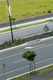 Mining Photo Stock Library - closeup looking across double lane road with nature strip planting ( Weight: 4  New Image: NO)