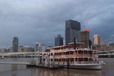 Mining Photo Stock Library - brisbane building skyline after a storm with paddle steamer boat on the river in foreground at wharf ( Weight: 5  New Image: NO)