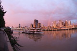 Mining Photo Stock Library - brisbane city skyline after storm with rainbow at sunset.  paddle steamer boat in foreground on the river. ( Weight: 5  New Image: NO)