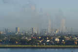 Mining Photo Stock Library - pollution and heavy industry in background with city and residential in front and river in foreground. carbon emission offset image. ( Weight: 1  New Image: NO)