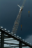 Mining Photo Stock Library - crane on steel construction site shot with storm in background. close up , good line and form. ( Weight: 5  New Image: NO)