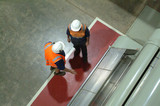 Mining Photo Stock Library - 2 workers in full PPE inside factory discussing.  shot from above. ( Weight: 4  New Image: NO)