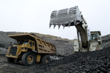 Mining Photo Stock Library - excavator loading coal from the open cut seam floor into a haul truck.  shot up close. ( Weight: 4  New Image: NO)