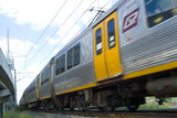 Mining Photo Stock Library - light rail passenger train moving. shot up close from track level. ( Weight: 3  New Image: NO)
