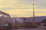 Mining Photo Stock Library - water sprayers at coal stockpiling area. shot at sunset ( Weight: 5  New Image: NO)