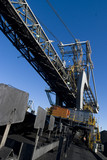 Mining Photo Stock Library - worker in ppe walking under coal reclaimer at terminal ( Weight: 5  New Image: NO)