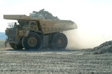 Mining Photo Stock Library - fully loaded haul truck on open cute mine site arrives to dump overburden. pile of dust. ( Weight: 2  New Image: NO)