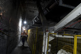 Mining Photo Stock Library - underground coal mine worker walking next to moving conveyor structure. ( Weight: 5  New Image: NO)