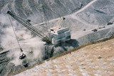 Mining Photo Stock Library - dragline stockpiling overburden in open cut coal mine with filled blast holes in foreground awaiting blasting. ( Weight: 3  New Image: NO)