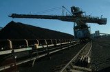 Mining Photo Stock Library - moving conveyor with a coal loader stockpiling in the background. shot late in the day and could be a  silhouette. ( Weight: 5  New Image: NO)