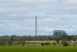 Mining Photo Stock Library - coal fired power station  in distance with prominent smokestck adjacent.  green fields in foreground. ( Weight: 2  New Image: NO)