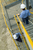 Mining Photo Stock Library - female site engineers walking down stairs.  railings painted safety yellow ( Weight: 3  New Image: NO)