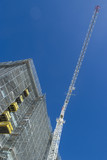Mining Photo Stock Library - tower crane at a multi level building site. deep blue sky behind ( Weight: 1  New Image: NO)