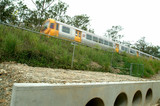 Mining Photo Stock Library - light rail passenger train passing over culvert with landscaped bank in middle ground. ( Weight: 1  New Image: NO)