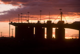 Mining Photo Stock Library - sunset Silhouette image of traffic moving on large bridge.  great colour in sky. ( Weight: 3  New Image: NO)