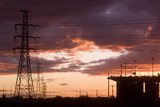 Mining Photo Stock Library - sunset Silhouette image of traffic moving on large bridge. giant powerlines nearby. great colour in sky. ( Weight: 3  New Image: NO)