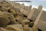 Mining Photo Stock Library - large concrete blocks as ocean retaining wall to stop beach erosion.  rock wall jetty's in background. ( Weight: 2  New Image: NO)