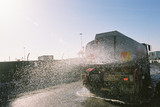 Mining Photo Stock Library - water cart truck spraying on a construction site for dust control. ( Weight: 5  New Image: NO)