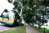 Mining Photo Stock Library - generic shot of a council bus in leafy street at a bus stop. footpath and park adjacent. ( Weight: 3  New Image: NO)