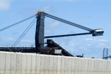 Mining Photo Stock Library - coal stacker reclaimer at terminal with concrete precast bunding in foreground. ( Weight: 5  New Image: NO)